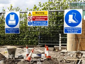 A work site displays safety signs