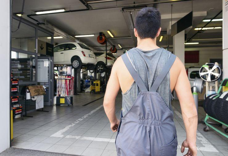 A mechanic returns to work